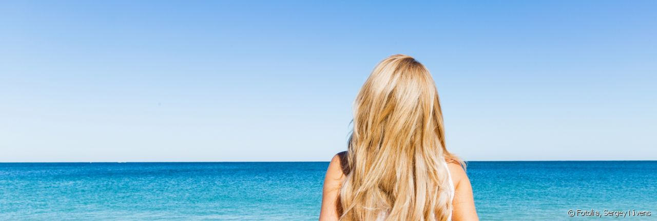 Protect your hair from UV rays with a sun protection treatment.