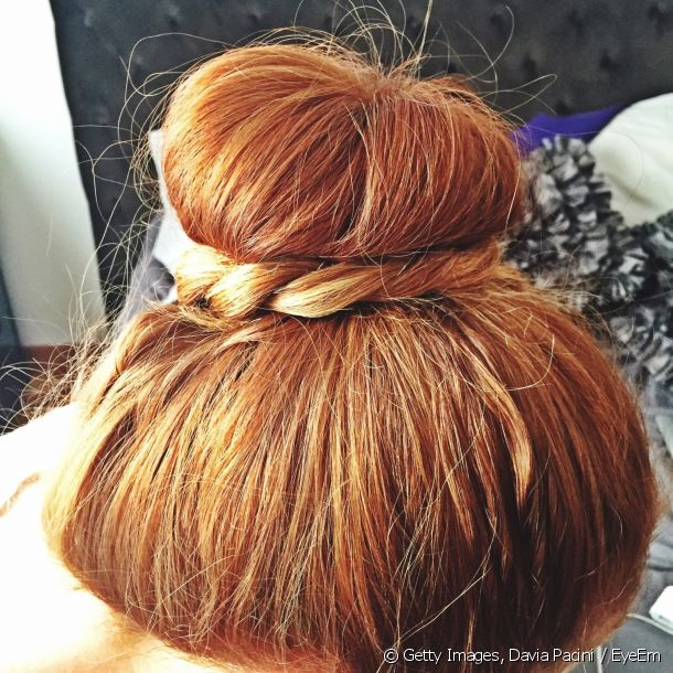 The braided chignon emphasises a romantic look.