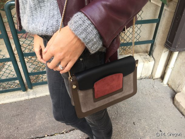 Julie enhances her outfit with layered colours on her handbag.