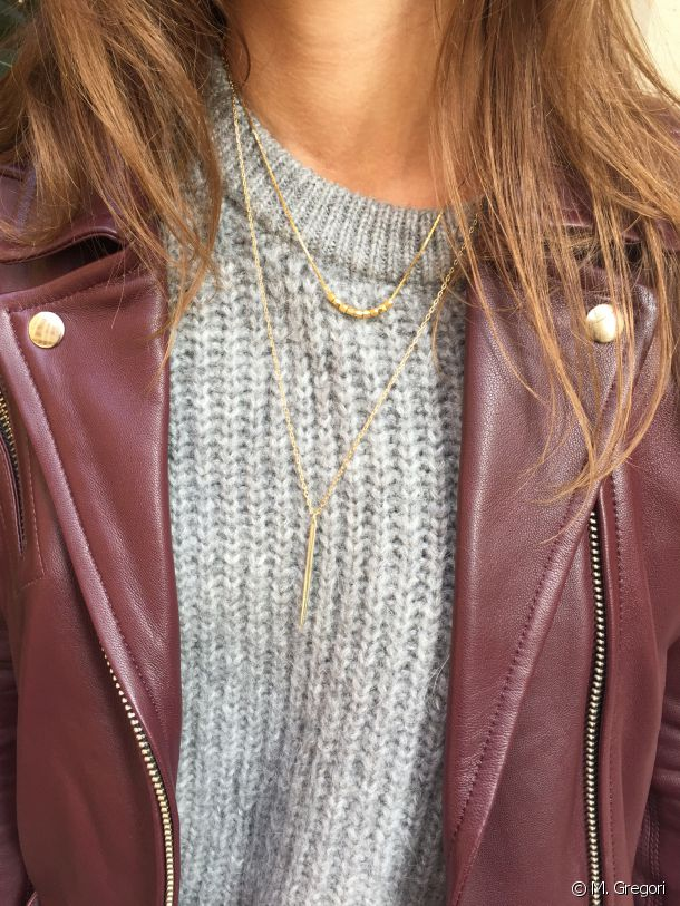 A great tip: layering necklaces to finish off a look.