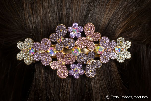 The hair slide moves with the times, set with rhinestones.