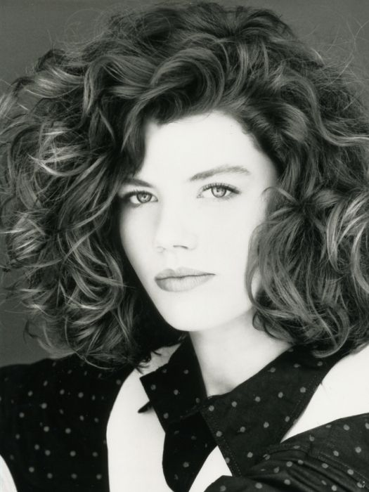 Voluminous waves looked more glamorous than ever with this version of the perm, giving it less of a 'beehive look' for a style similar to that of Charlie (Kelly McGillis) in Top Gun!
