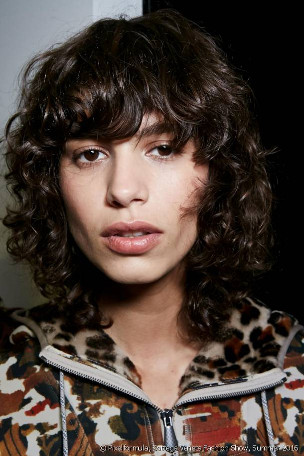 Dare to try the fringe and curly/wavy hair combo!
