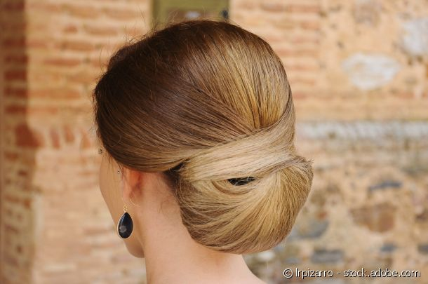 A low cross-over effect chignon for optimum impact.