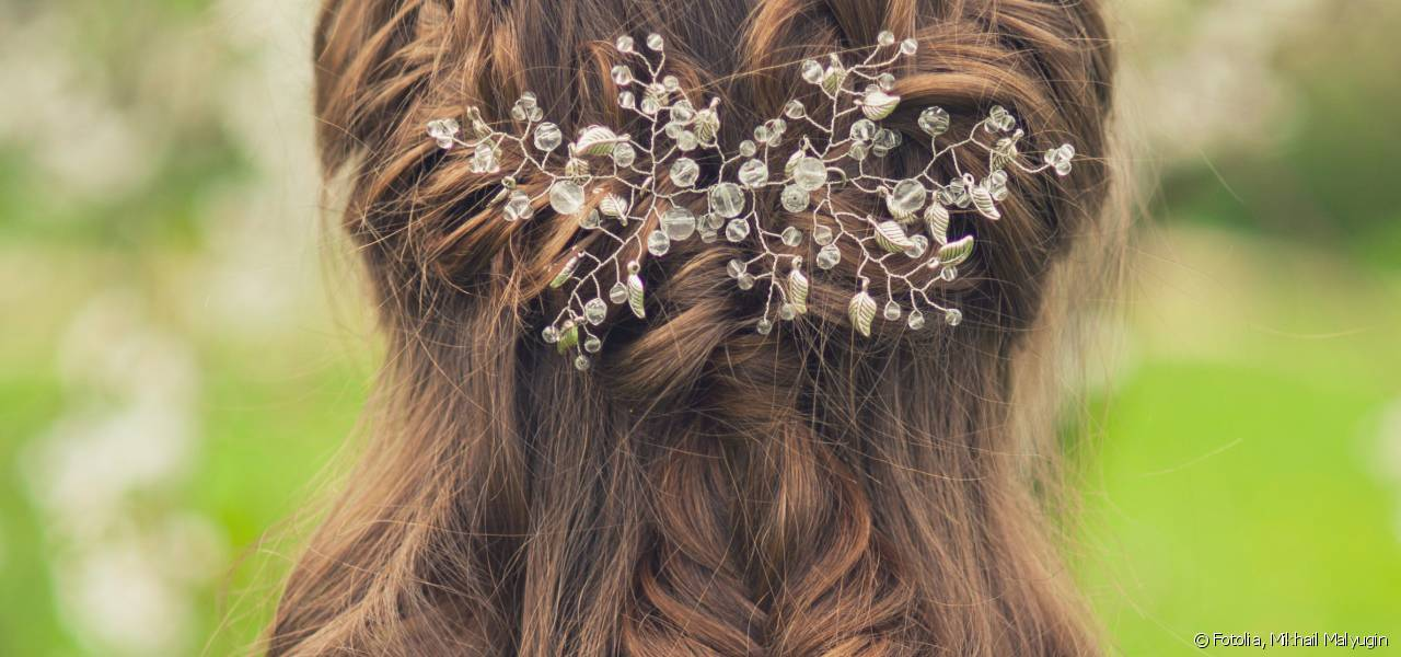 Fall in love with the romantic half-ponytail embellished with a few plaits.