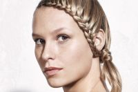 A new creation by the Style Bar, this braided hairstyle adds a twist to the shoulder-length cut.