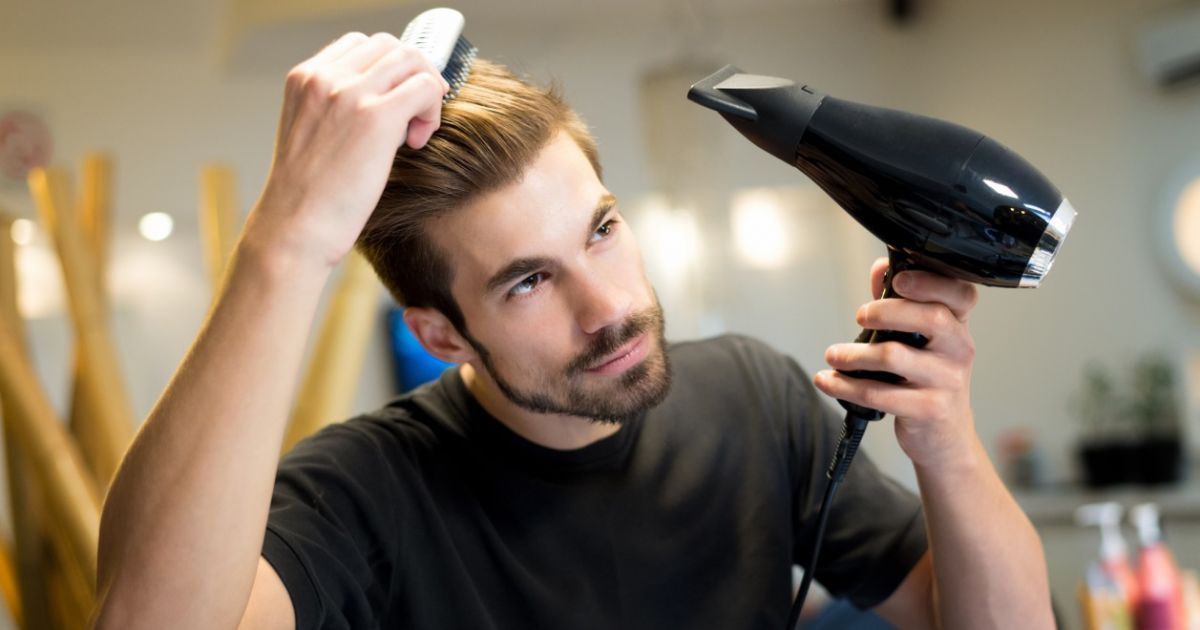 Image result for high-quality images of man blowdrying hair article on how to straighten hair
